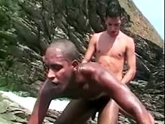White homosexual pounds black by the sea
