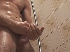 Pretty chap jerks off his taut penis in the washroom