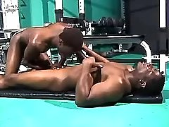 Black gay guy sucks chocolate dong in gym