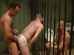 Two full-grown prisoners fuck guy by stoops