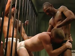 Two black guards get from poor prisoner