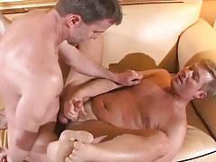 Mature homosexual bonks bushy man on sofa