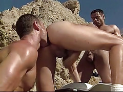 Gay hunk sucks knob and licked by friend in desert